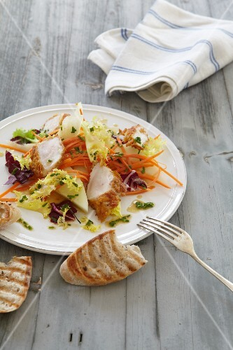A spring salad with carrots and chicken