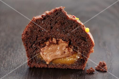 A chocolate muffin filled with orange and chocolate cream