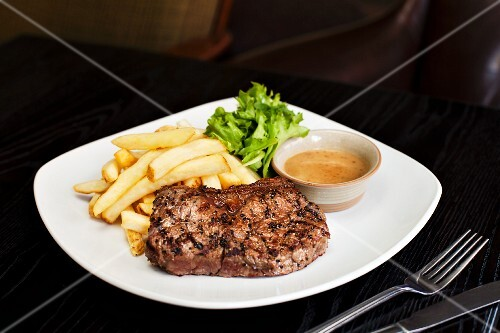 Beef steak with chips and sauce