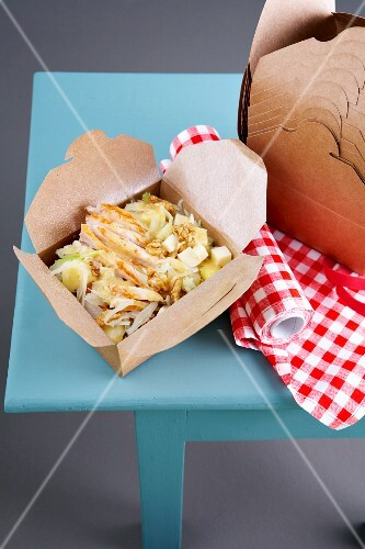 A salad of chicken, apple, cabbage, Gruyère and nuts