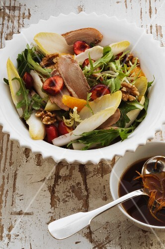 Leaf salad with duck, cherries and walnuts