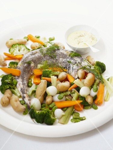 Fish with colourful vegetables and dip