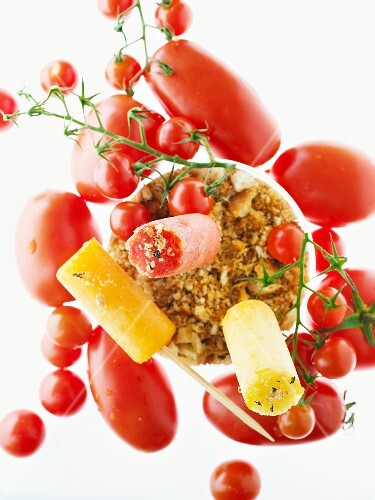 A still life of tomatoes, breadcrumbs and mini gazpacho ice lollies
