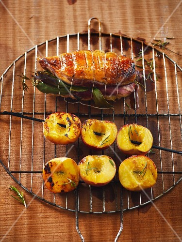 Stuffed chicken breast and barbecued peaches