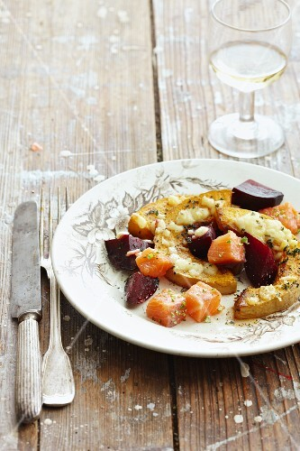 Baked squash with beetroot and salmon