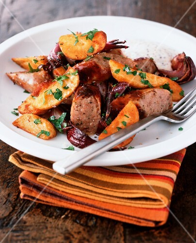 Fried sausage with potato wedges and Cumberland sauce