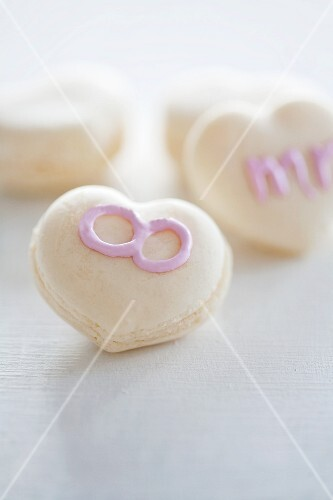 Macaroons decorated with writing using sugar icing
