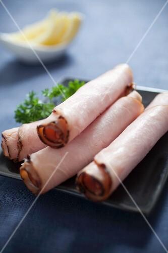 Rolls of smoked turkey ham