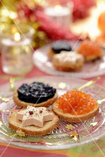 Canapés with goose liver and caviar for Christmas