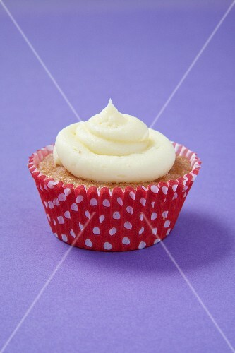 A cupcake in a red and white polka-dot paper case