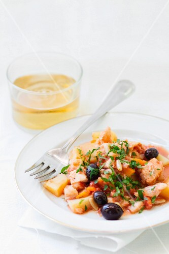Pot-roasted cod with potatoes, olives and pine nuts