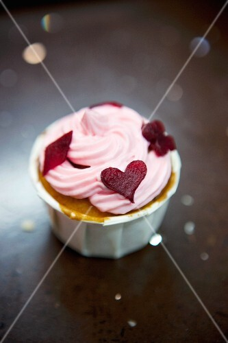 A cupcake topped with beetroot