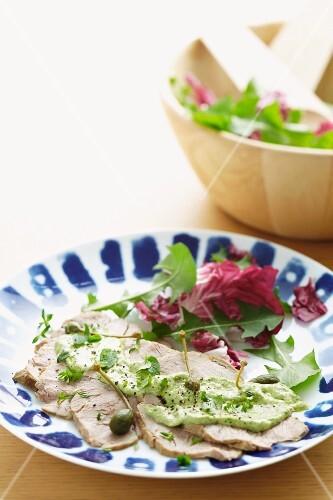 Vitello tonnato served with a salad