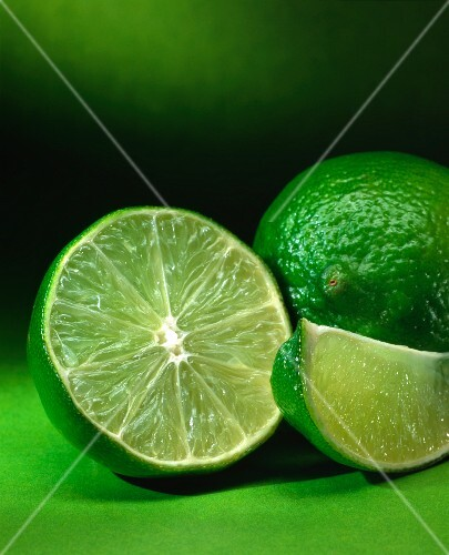 A lime, a lime half and a wedge of lime