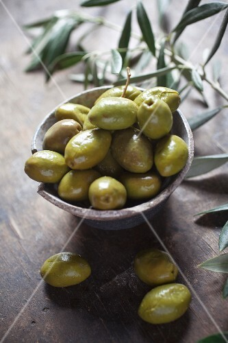 Green olives in a ceramic dish