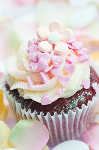 Chocolate cupcake decorated with pink sugar hearts