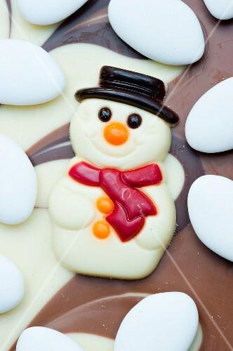 White chocolate snowman and sugared almonds