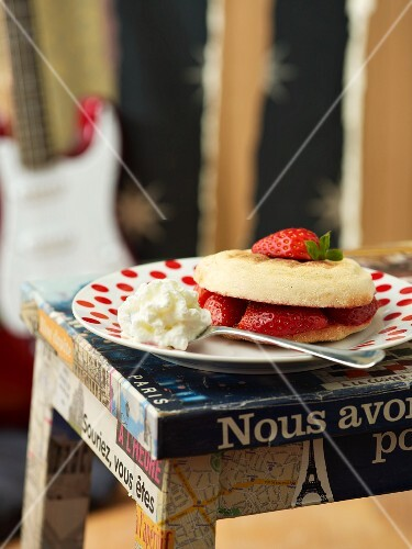 A muffin with strawberries and cream