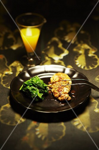 Breaded sweetbread with spinach
