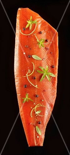 Smoked side of salmon with herbs and spices