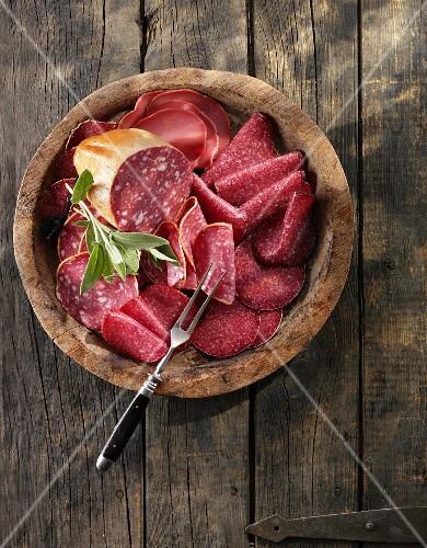 Assorted salamis and cervelat sausages