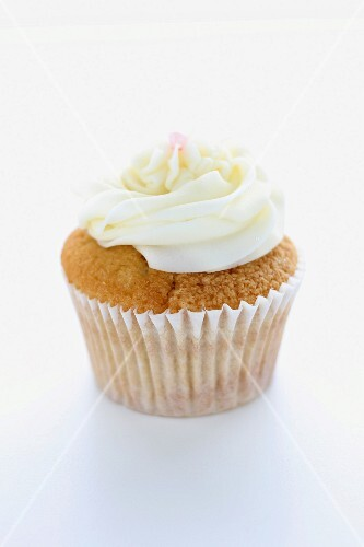 A cupcake topped with buttercream icing