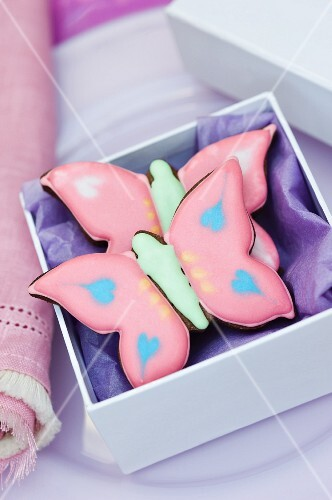 Two pink 'butterfly' cookies for gifting