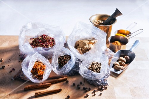 Assorted spices, some in plastic bags