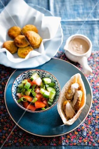 Falafel in pita bread and vegetable salad