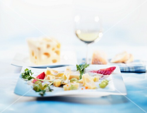 Pieces of cheese with grapes