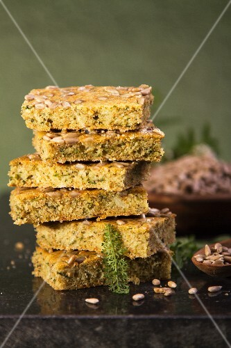Stacked slices of herb bread with sunflower seeds