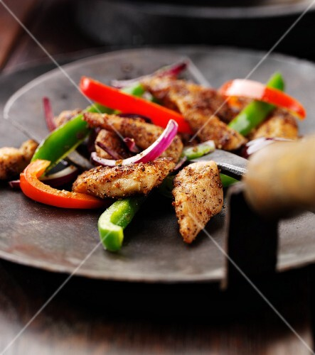 Sauteed chicken with peppers and onions