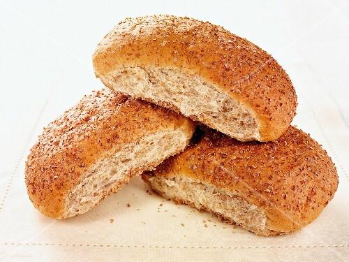 Three oval bread rolls