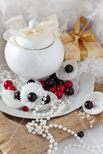 Christmas decorations with a covered china pot, ball ornaments and a string of pearls