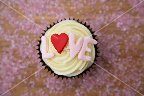 Chocolate cupcake with 'love' written on it