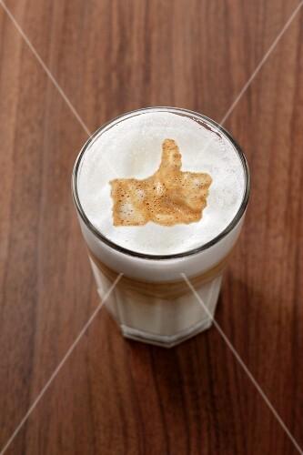 Latte macchiato with the 'Like' symbol
