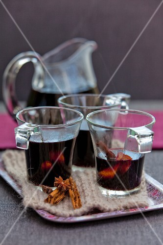 Mulled wine in glasses and a glass pitcher