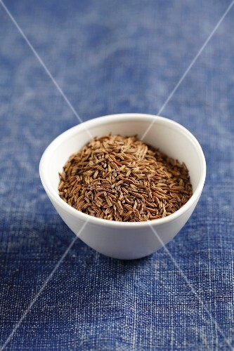 A small bowl of cumin seeds