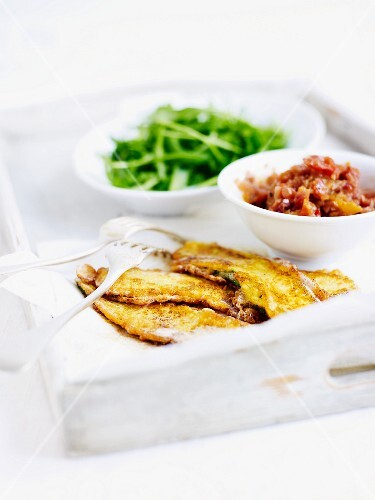 Courgette piccata with tomato chutney and rocket leaves
