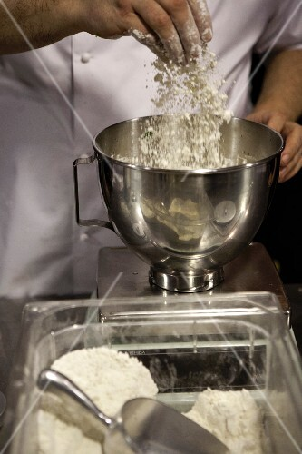 The flour being added