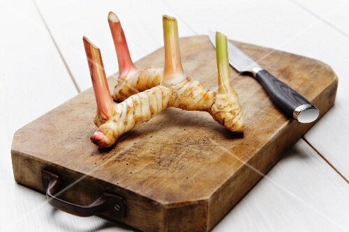 Galangal (Thai ginger) on a chopping board