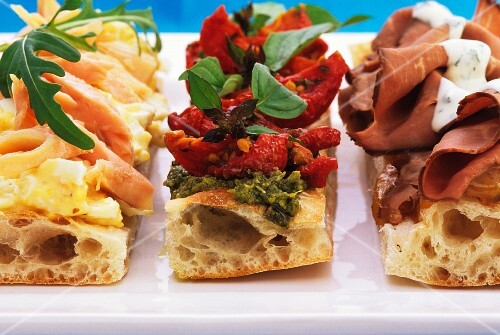 Sliced savoury flatbread with assorted toppings