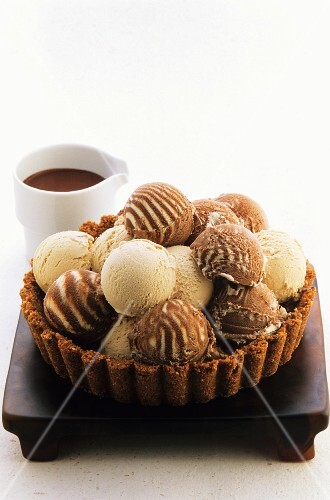 A tart case filled with scoops of icecream