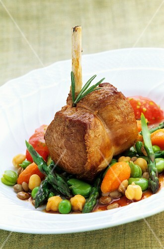 Saddle of lamb on a bed of vegetables