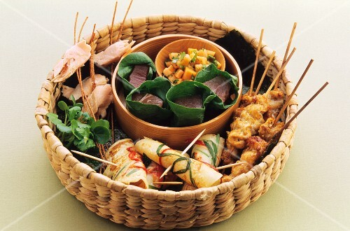 Pancake rolls and skewers in a basket