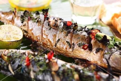 Grilled mackerel with herbs, chilli rings and limes