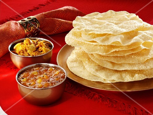 Assorted chutneys and poppadoms (India)