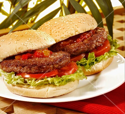Hamburgers with tomatoes and lettuce