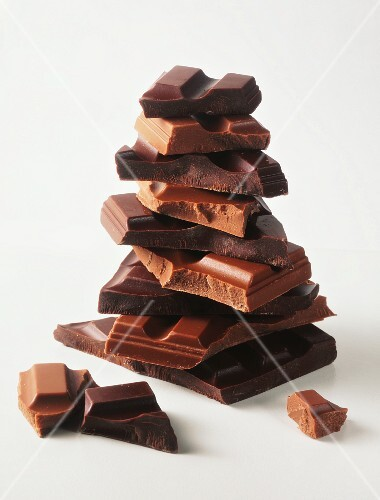 A stack of assorted chunks of chocolate