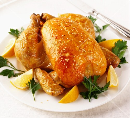 A whole roast chicken with sesame seeds